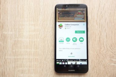 KONSKIE, POLAND - JUNE 17, 2018: Calibre Companion app on Google Play Store website displayed on Huawei Y6 2018 smartphone