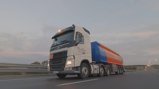 fuel truck with tank is driving on road with flashing special signals. Domodedovo, Russia - October 01, 2020.