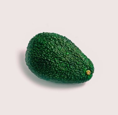 Vertical photo depicting natural beautiful ripe avocado. Delicious single fresh green avocado isolated on a white background with shadow, close up. Hass or Puebla type.