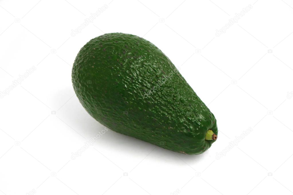 Delicious fresh ripe green avocado isolated on a white background, natural shadow.