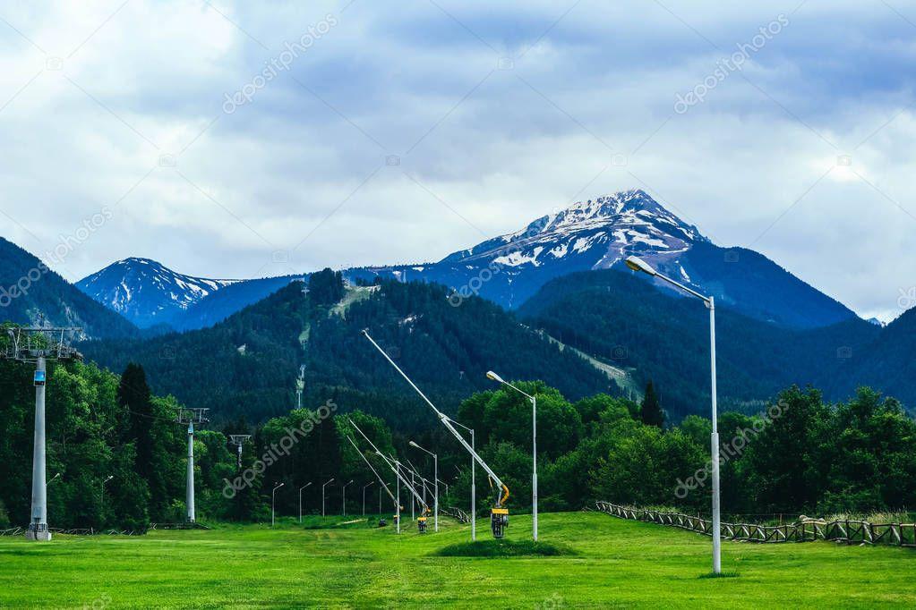 Ski and snowboarding resort in Bulgaria, Bansko. Mountains with snow peak, summer.
