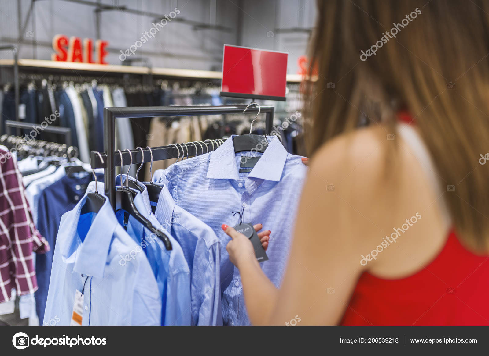 Happy Woman Retail Clothing Shop Shopper Looking Price Tag