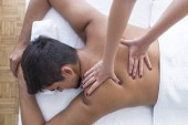 Fotografie Masseur doing back massage at man in spa salon
