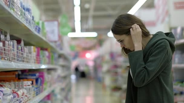Female shopping in a large supermarket