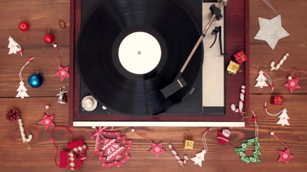 Top view - old vintage vinyl playing christmas music with decoration.