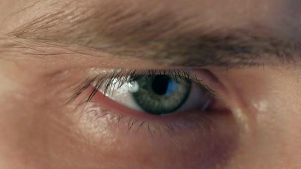 extreme close up eye of man working at laptop at night