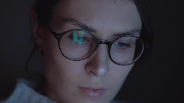 Beautiful woman use smartphone at night. Close up. 4k.