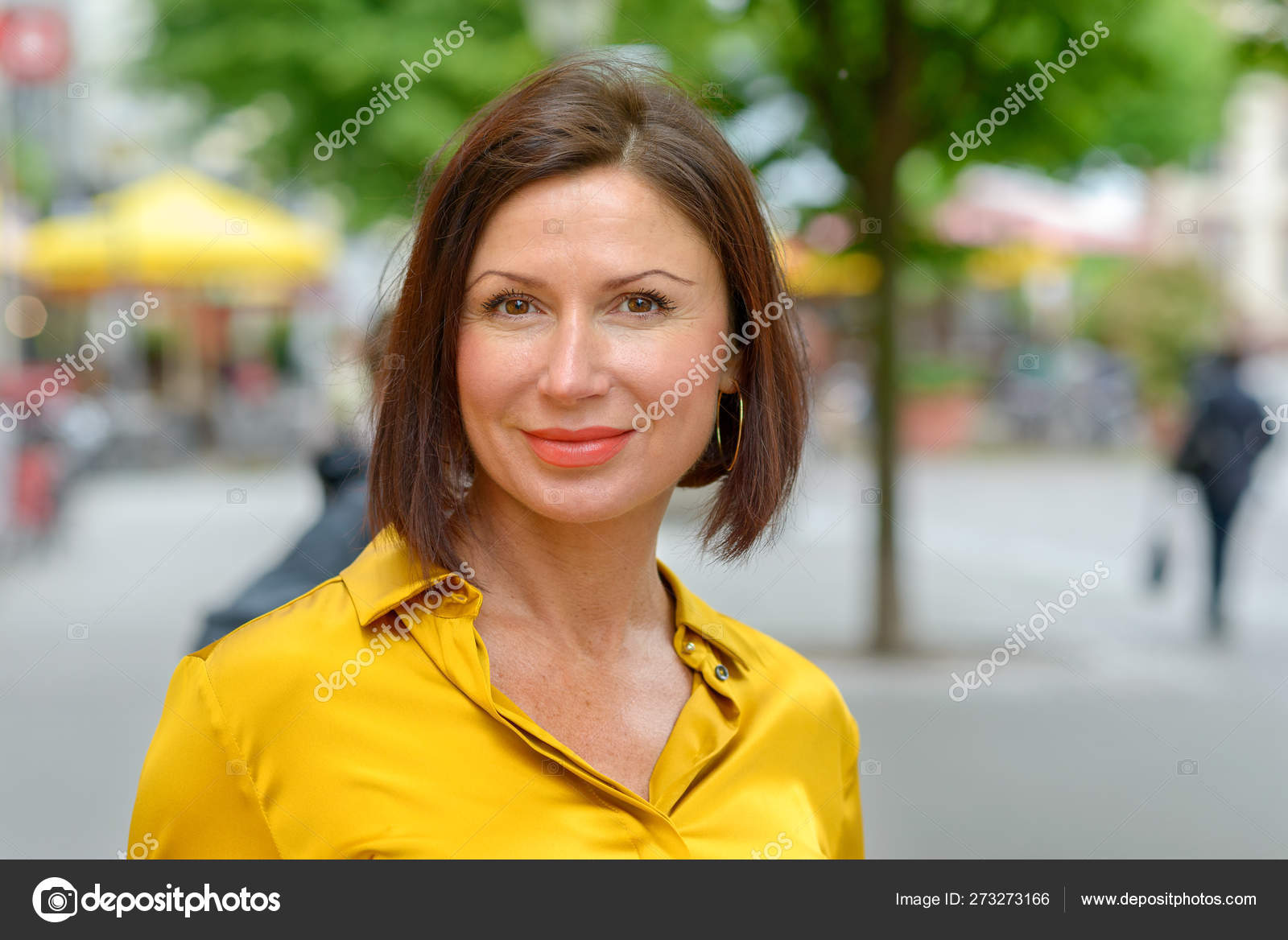 Attractive Mature Woman Enjoying A Day In Town Stock Photo
