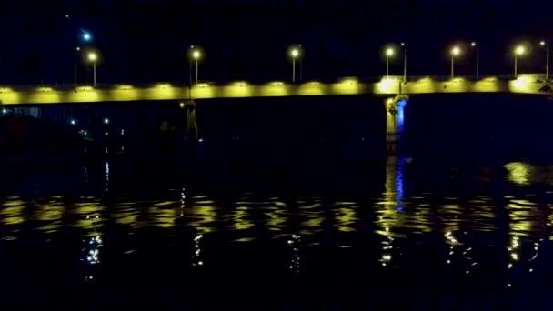 Yellow lights illuminate the bridge