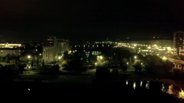 Night city on the river Bank
