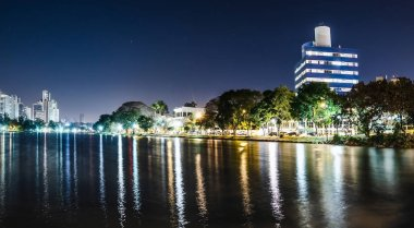 Photo of the Lago Igapo, Londrina - Parana, Brazil. View of the Igapo lake at night and the city, buildings on background. Leisure place, touristic destination of the city.