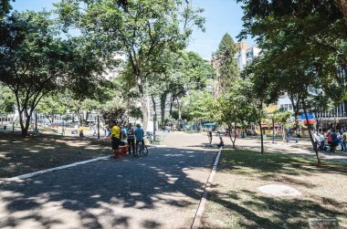 Londrina - PR, Brazil - December 12, 2018: Ordinary day at Marechal Floriano Peixoto square (Praca da Bandeira) in Londrina city. Square with people, some benches on the downtown.