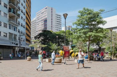 Londrina - PR, Brazil - December 12, 2018: Parana avenue, downtown street with commerce, local people and historic buildings. Gabriel Martins square. Calcadao (Calcadao de Londrina).