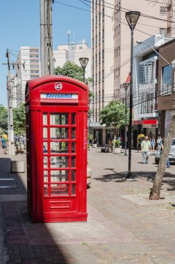 Londrina - PR, Brazil - December 12, 2018: Sercomtel red telephone booth on downtown of the city. Red phone cabin inspired on london's phone booth.