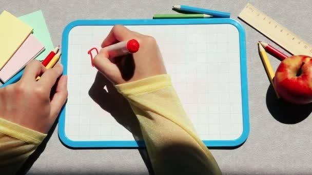 Back to school, hand write words on blackboard