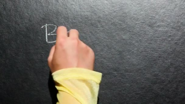 Back to school, hand write words on blackboard with chalk, education concept