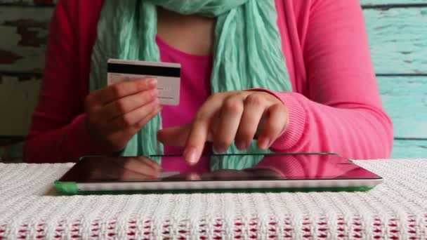 Online shopping, woman with credit card in hand paying or booking in internet