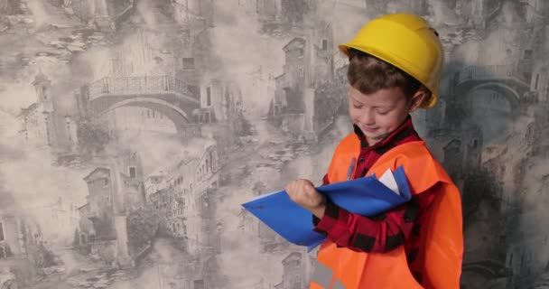 Architect In Helmet Writing Something Near The Wall. Little Cute Boy As An Architect