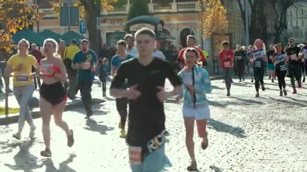 Group of athletes, healthy people running down street, taking part in marathon