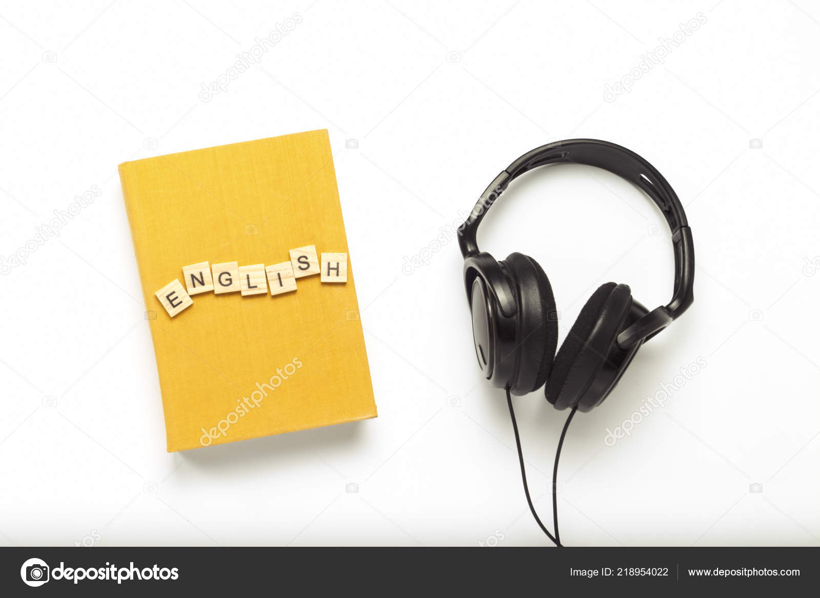 Book Yellow Cover Text English Black Headphones White