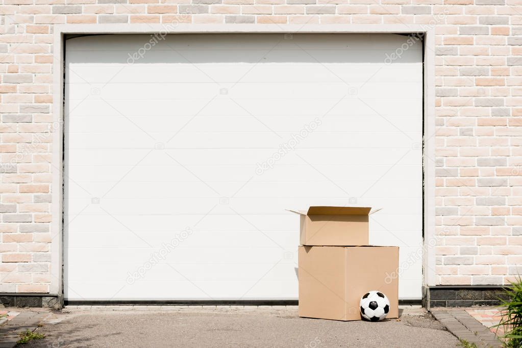 front view of boxes, soccer ball in front of garage gate