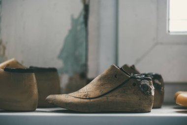 close-up view of unfinished footwear workpieces at shoemaker workshop
