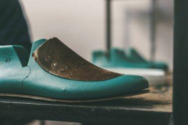 Close-up shot of shoe last in cobbler shop stock vector