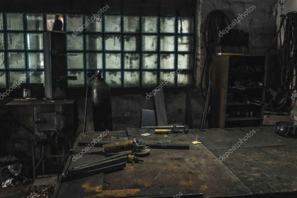 Empty welder workplace with various supplies in workshop stock vector