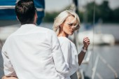 beautiful stylish young couple spending time together on yacht