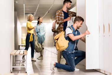 young students spending time together in college corridor