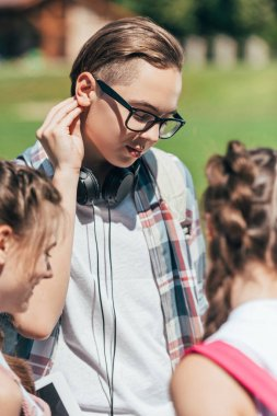 cropped shot of teenagers spending time together in park