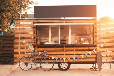 food truck with bicycle during sunset
