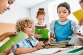 schoolchildren writing off homework of their classmate during break