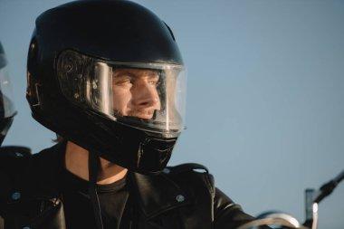 Portrait of man in motorcycle helmet looking away stock vector