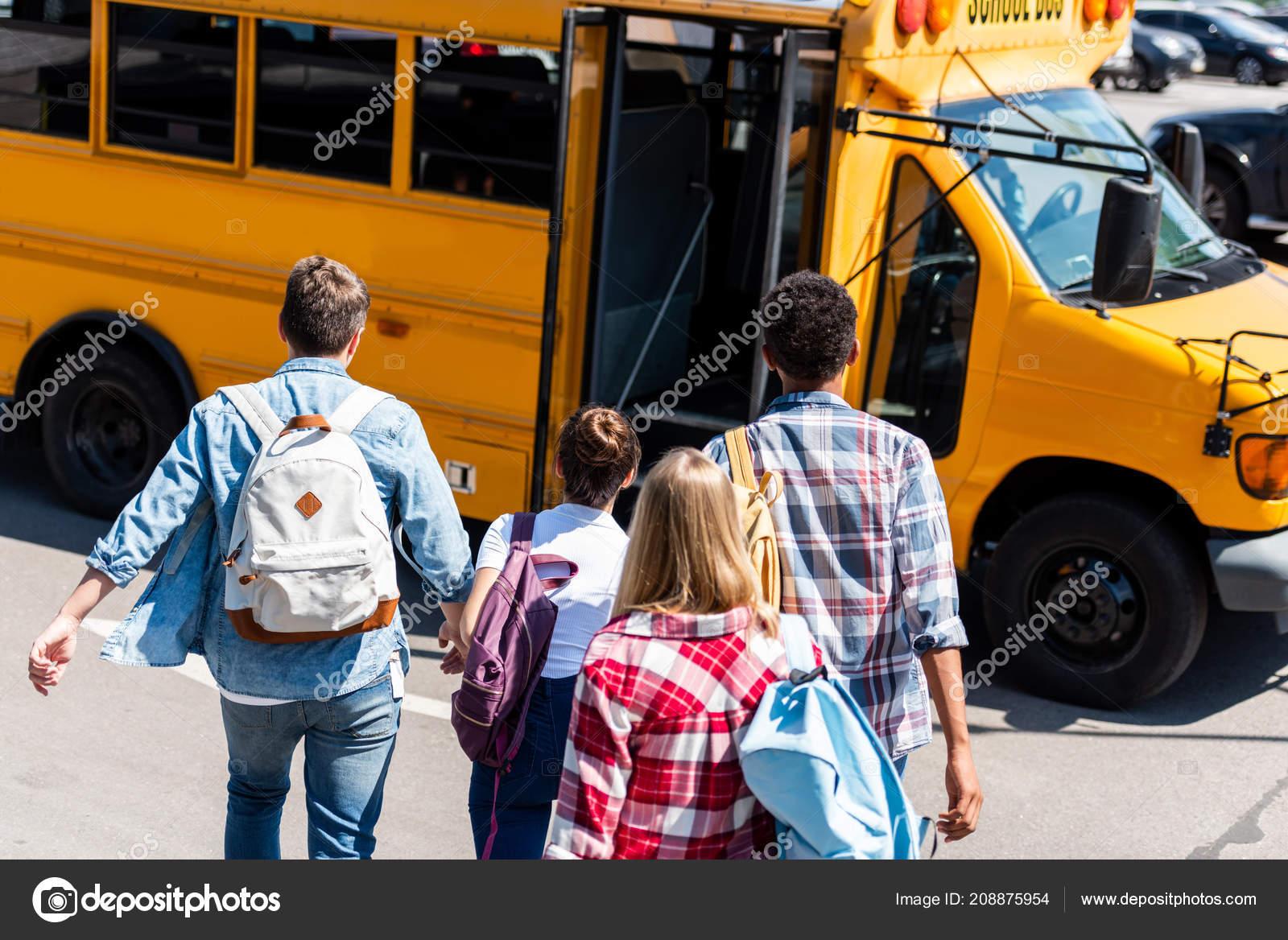 Rear View Group Teen Students Walking School Bus School — Stock Photo