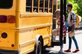 Fotografie couple of teen students walking in school bus