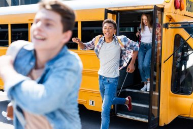 Group of teen students running out of school bus stock vector