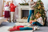 Photo happy family decorating living room for christmas together