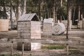 scenic view of paintball club with wooden constructions and trees outdoors
