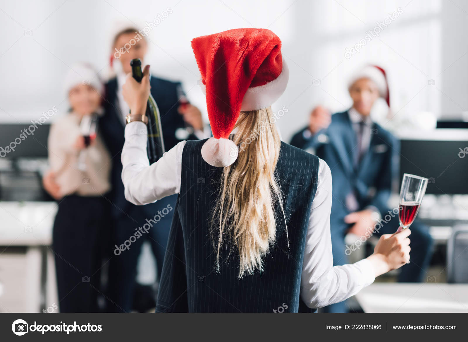 b24724c0bb6 Back View Businesswoman Santa Hat Holding Glass Bottle Champagne While —  Stock Photo