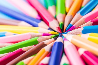 Education or back to school Concept. Close up macro shot of color pencil pile pencil nibs on white background.