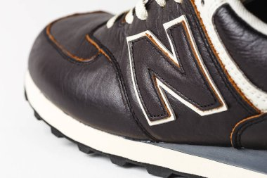 Moscow, Russia - Circa August 2018 : New Balance Shoes logo - letter N on new leather sneakers. New Balance - American manufacturer of sportswear