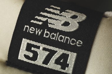 Moscow, Russia - Circa August 2018 : New Balance Shoes logo - letters NB and 574 model on new sneakers. New Balance - American manufacturer of sportswear