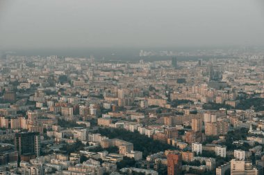 Aerial top view of Moscow city from above, roads with car traffic, cityscape panorama, buildings in evening dusk