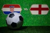 Soccer 2018. Creative concept. Soccer ball on green grass. England and Croatia. Selective focus