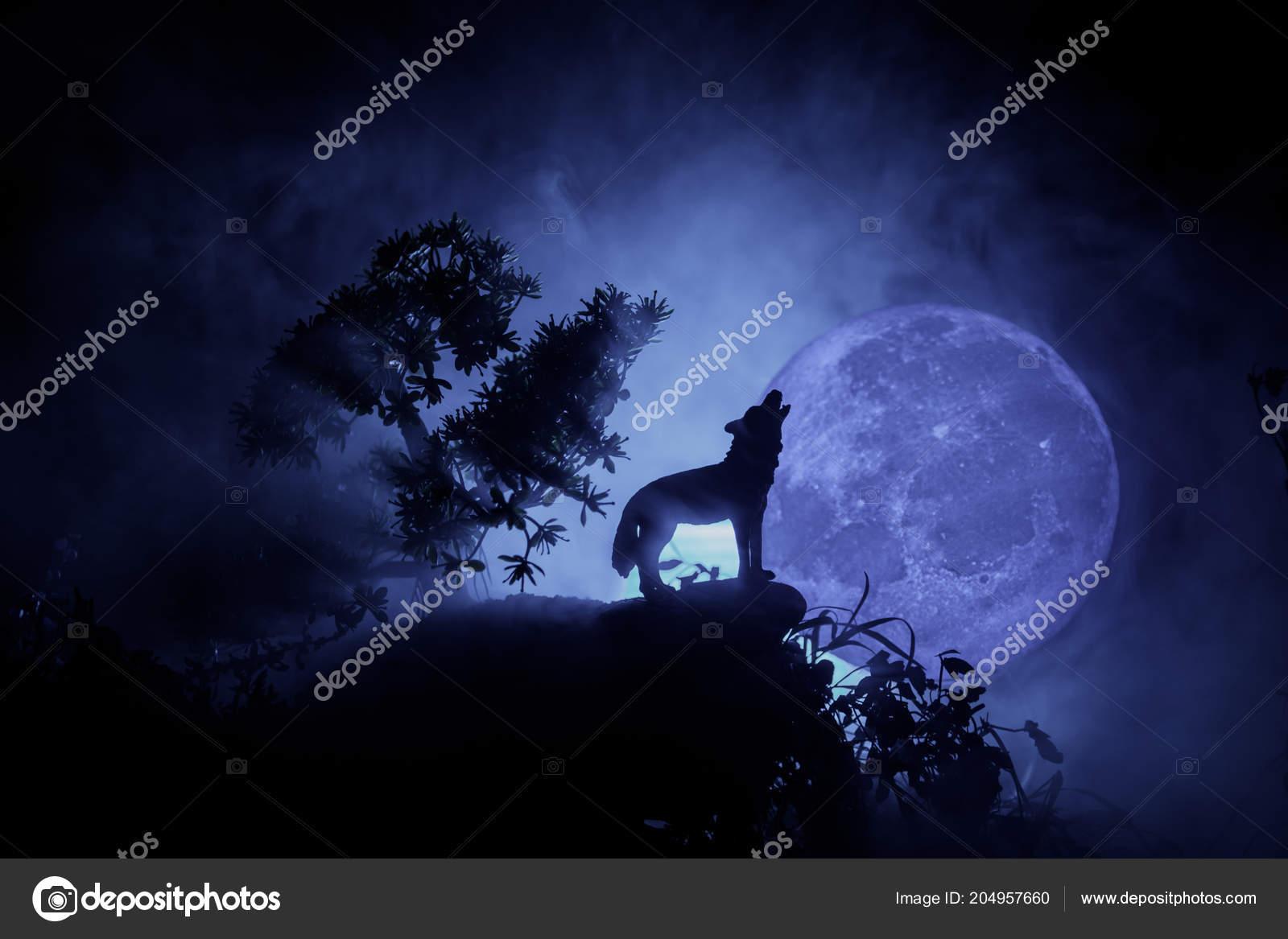 depositphotos 204957660 stock photo silhouette howling wolf dark toned