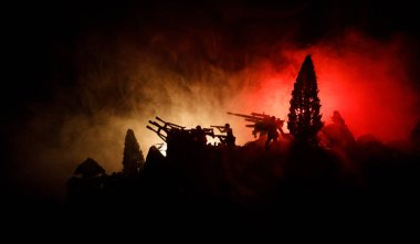 War Concept. Military silhouettes fighting scene on war fog sky background, World War Soldiers Silhouettes Below Cloudy Skyline At night. Attack scene. Armored vehicles. Selective focus. Decoration