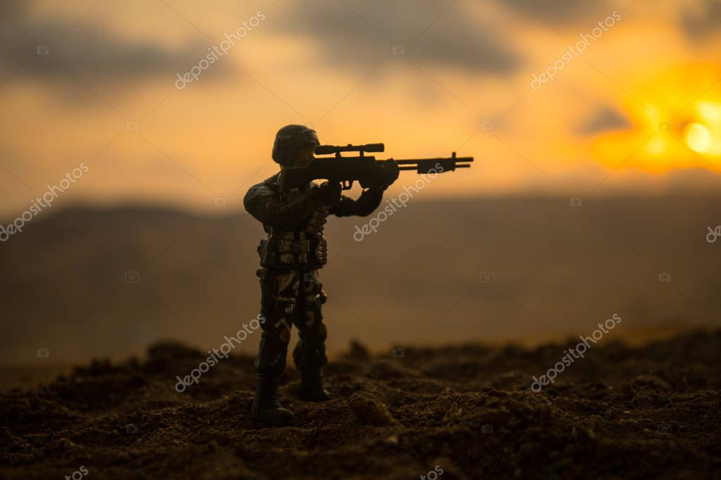 Silhouette of military soldier or officer with weapons at sunset. shot, holding gun, colorful sky, mountain, background. Decoration with toy soldier stock vector