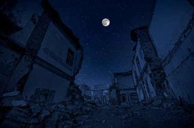 Full moon over the ruins of old grunge building at night. Beautiful night landscape with full moon
