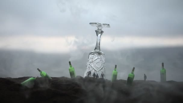 Abstract alcoholism concept. People in under a giant glass like in prison. Creative artwork decoration. Selective focus